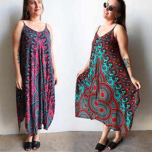 Womens flowing summer tunic dress with midi hankerchief hemline and adjustable spaghetti straps in exotic print. Generous one size fit flatters petite to plus size up to size 18