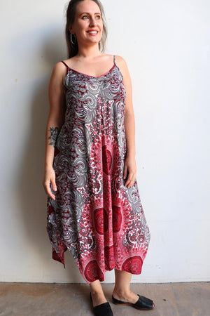Womens flowing summer tunic dress with midi hankerchief hemline and adjustable spaghetti straps in exotic print. Generous one size fit flatters petite to plus size up to size 18 - Burgandy