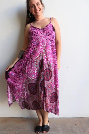 Womens flowing summer tunic dress with midi hankerchief hemline and adjustable spaghetti straps in exotic print. Generous one size fit flatters petite to plus size up to size 18 - Pink