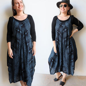 Womens flowing summer tunic dress with midi handkerchief hemline and adjustable spaghetti straps in exotic print. Generous one size fit flatters petite to plus size up to size 18 - Midnight Blue.