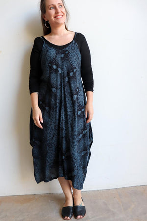 Womens flowing summer tunic dress with midi hankerchief hemline and adjustable spaghetti straps in exotic print. Generous one size fit flatters petite to plus size up to size 18 - Midnight Blue