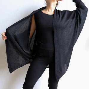 Fame Cardigan is a handy autumn-winter knit with batwing shaping giving plenty of room for all sizes. Versatile enough to throw over light and heavy layers. Available in sizes S/M - L/XL. Black.