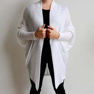 Fame Cardigan is a handy autumn-winter knit with batwing shaping giving plenty of room for all sizes. Versatile enough to throw over light and heavy layers. Available in sizes S/M - L/XL. White.