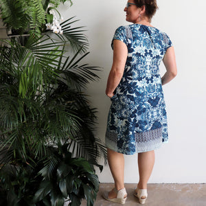 Women's blended-linen knee-length Summer Dress. Smart-casual tunic dress in a rich blue floral print in sizes 8-24. Back View.