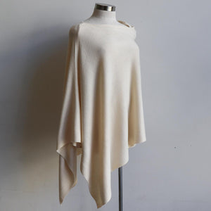 Women's Fine Knit Poncho Wrap. Elegant & versatile winter top can be worn multiple ways, one fit sizing. Made with easy-care acrylic fibre. Cream.