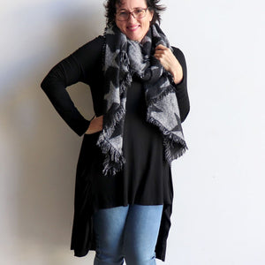 Fireside Wrap Scarf in Stars is a minky soft fibre winter knit accessory. Black on Karen