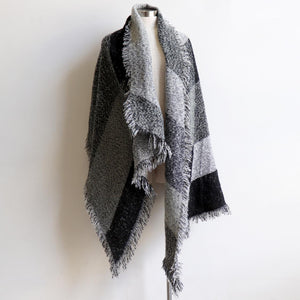 Fireside Wrap Scarf in plaid is a minky soft fibre winter knit accessory. Charcoal grey.