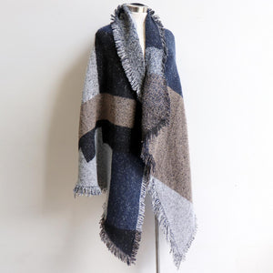 Fireside Wrap Scarf in plaid is a minky soft fibre winter knit accessory. Navy blue/charcoal.