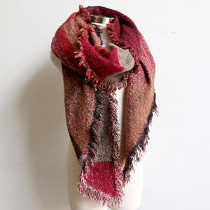 Fireside Wrap Scarf in plaid is a minky soft fibre winter knit accessory. Rust/Warm berry wrapped view.