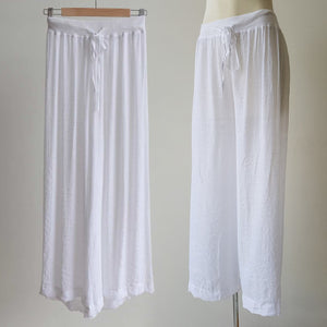 Women's wide-leg semi-sheer lounge beach pants with drawstring. Wear spring to summer on the hips or high waisted options. Great for tropical travel and casual floaty coast look. Plus sizes available up to a size 20 - White