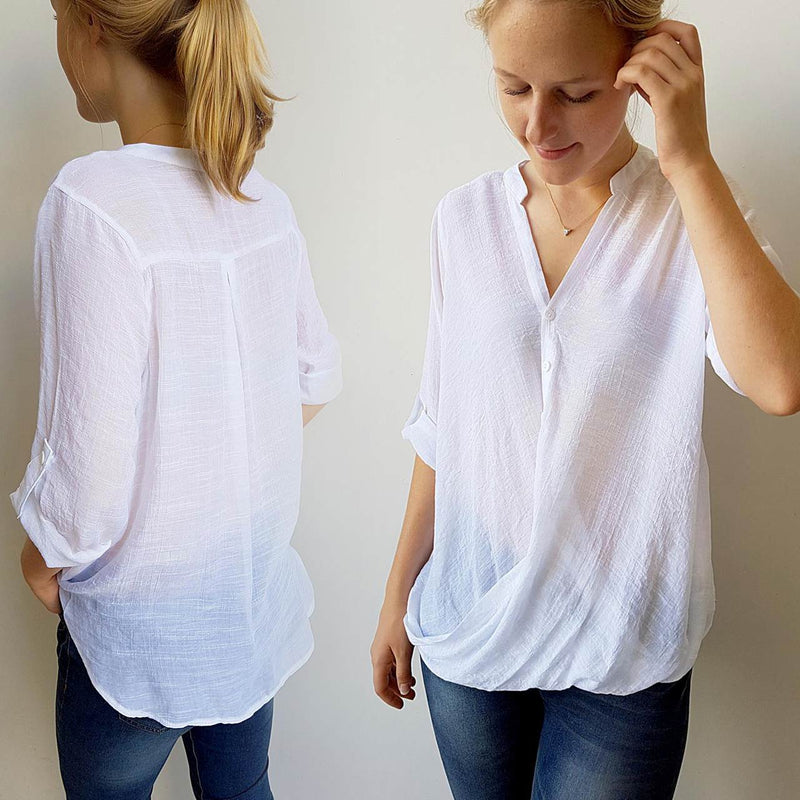 Womens shirt blouse featuring foldover detail and buttons. Comfortable, loose fitting and generous cut with cuffed sleeve detail that can be worn at half or 3/4 length for spring to summer. Plus sizes available up to size 20 - White
