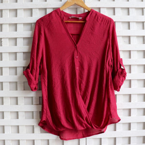 Womens shirt blouse featuring foldover detail and buttons. Comfortable, loose fitting and generous cut with cuffed sleeve detail that can be worn at half or 3/4 length for spring to summer. Plus sizes available up to size 20 - Sangria.