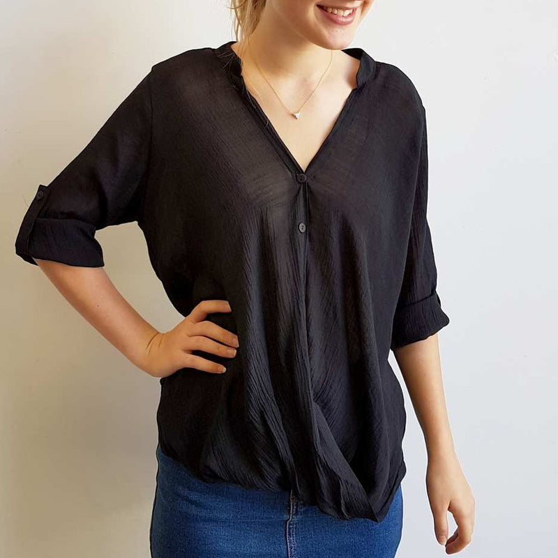 Womens shirt blouse featuring foldover detail and buttons. Comfortable, loose fitting and generous cut with cuffed sleeve detail that can be worn at half or 3/4 length for spring to summer. Plus sizes available up to size 20 - Black