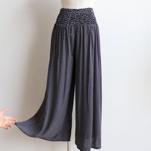Free Spirit Wrap Pant in Polka Dot, a classic wide-leg palazzo style for summer and winter wardrobes. Back view.