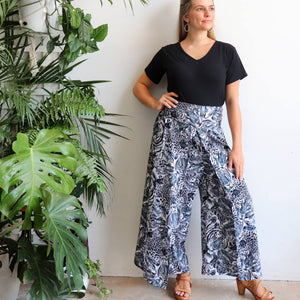 Free Spirit Wrap Pant in a modern palazzo style for lovers of animal print. Black. Front stance.