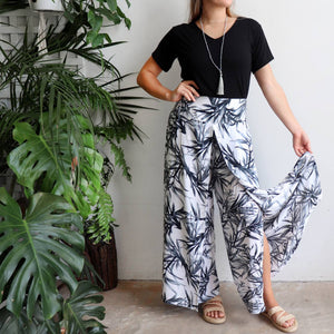 Free Spirit Wrap Pant is a classic wide-leg palazzo style with elegant monochrome bamboo leaf print.. Open leg.