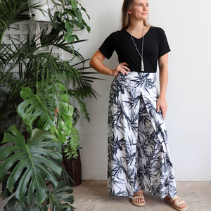Free Spirit Wrap Pant is a classic wide-leg palazzo style with elegant monochrome bamboo leaf print.. Front view.