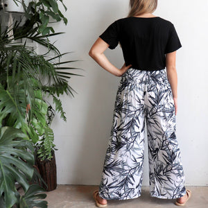 Free Spirit Wrap Pant is a classic wide-leg palazzo style with elegant monochrome bamboo leaf print. Back view.