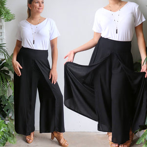 Free Spirit Wrap Pant in black is a classic palazzo design for work or casual wear. Double view.
