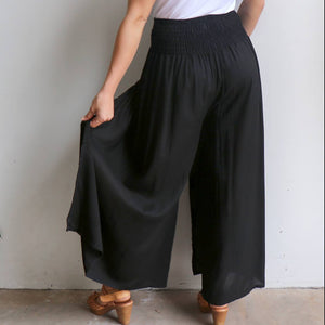 Free Spirit Wrap Pant in black is a classic palazzo design for work or casual wear. Back view.
