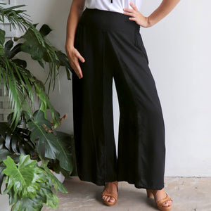 Free Spirit Wrap Pant in black is a classic palazzo design for work or casual wear. Front view.