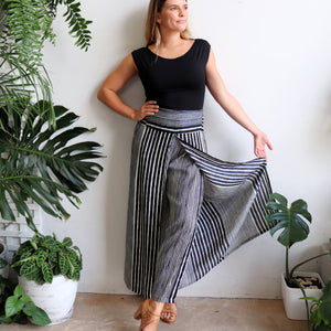 Free Spirit Wrap Pant in a modern stripe, a classic palazzo style for your smart-casual wardrobe. Black. Front view.