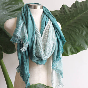 Large elegant scarf with tonal shadings and a fine raw fringe edging. 100% viscose. Dark Green.