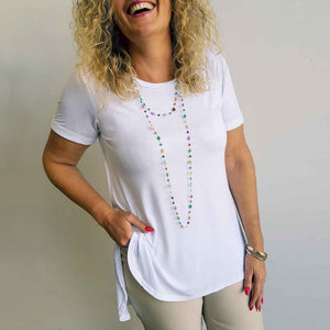 Gemini short sleeve tee + nude beige capris. High neck + low back. White