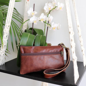 Ethical & hand made genuine leather purse with double zip and wrist strap. Perfect accessory for your iPhone. Brown