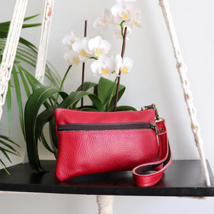 Ethical & hand made genuine leather purse with double zip and wrist strap. Perfect accessory for your iPhone. Red.