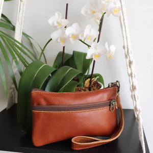Ethical & hand made genuine leather purse with double zip and wrist strap. Perfect accessory for your iPhone. Tan.