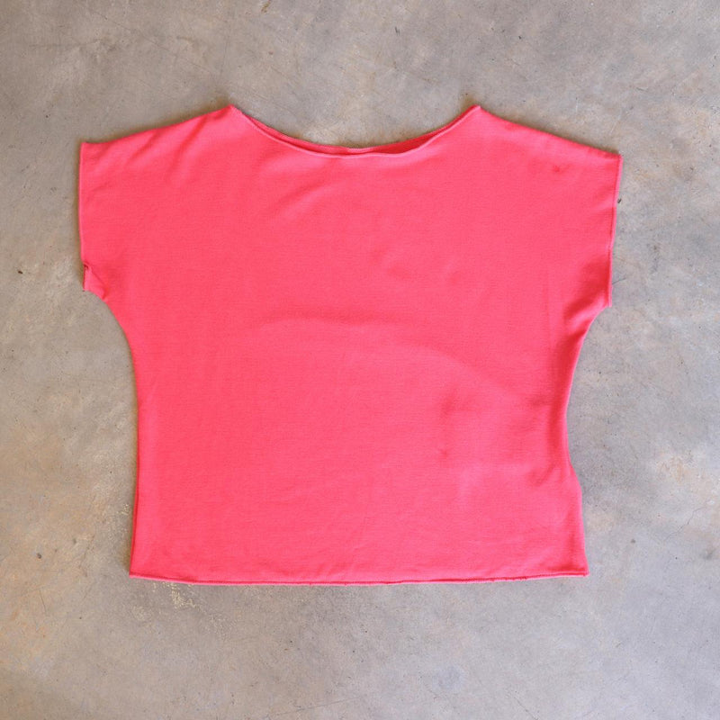 Girls summer square cut, plain t-shirt basic top. Sizes to fit newborns, toddlers, kids and  tweens up to 10 years old. Ethically handmade with soft, stretch bamboo spandex. Coral Pink