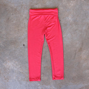 Girls and boys full length legging tights with wide, yoga foldover waistband. Comfy fit and great layer. Sizes to fit newborns, toddlers, kids and tweens up to 10 years old. Ethically handmade with soft, stretch bamboo spandex. Coral Pink
