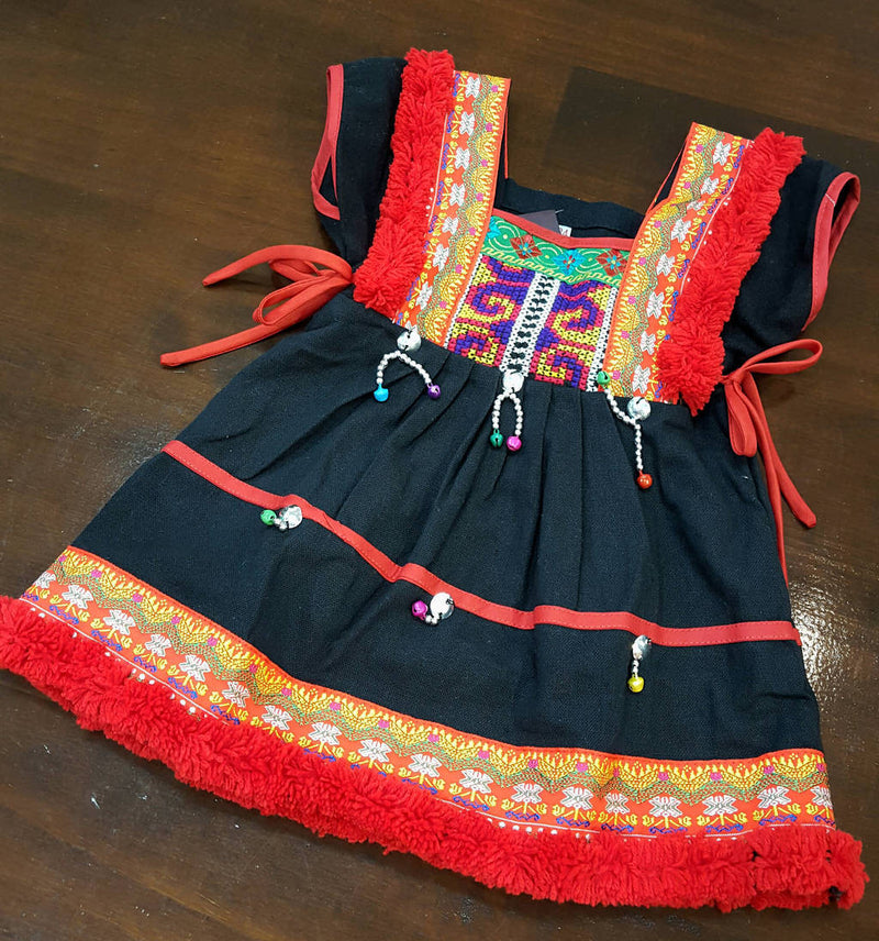Girl's Hill Tribe Tunic Dress with red pompom trims and traditional tapestry. Yellow.