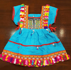 Girl's Hill Tribe Tunic Dress with rainbow pompom trims and traditional tapestry. Blue.