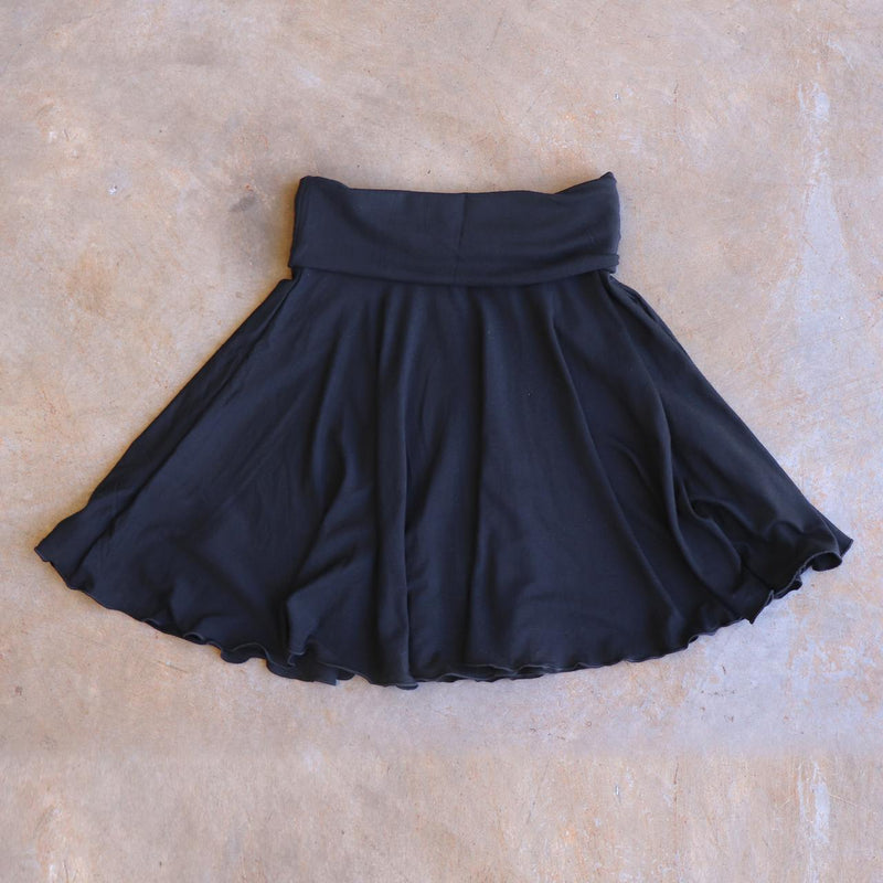 Girls full circle skirt with wide, yoga foldover waistband. Comfy fit and great for ballet class. Sizes to fit newborns, toddlers, kids and tweens up to 10 years old. Ethically handmade with soft, stretch bamboo spandex. Black