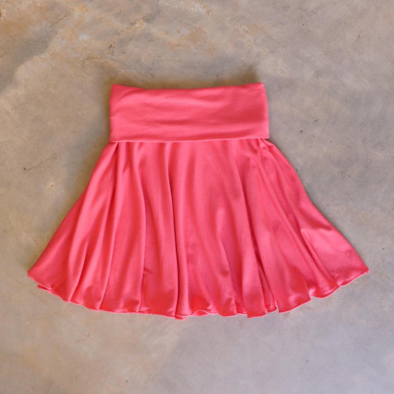 Girls full circle skirt with wide, yoga foldover waistband. Comfy fit and great for ballet class. Sizes to fit newborns, toddlers, kids and tweens up to 10 years old. Ethically handmade with soft, stretch bamboo spandex. Coral Pink