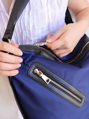 Soft nylon twill handbag that converts into backpack with zip features. Navy Blue.