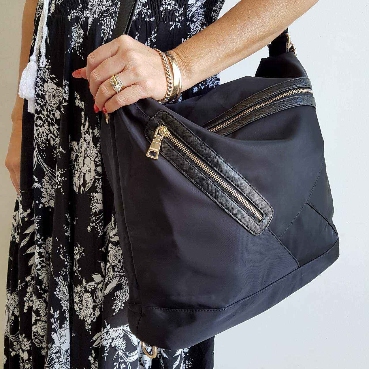 Soft nylon twill handbag that converts into backpack with zip features.  Black ... 8215207f626fb