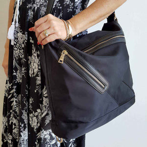 Soft nylon twill handbag that converts into backpack with zip features.  Black/