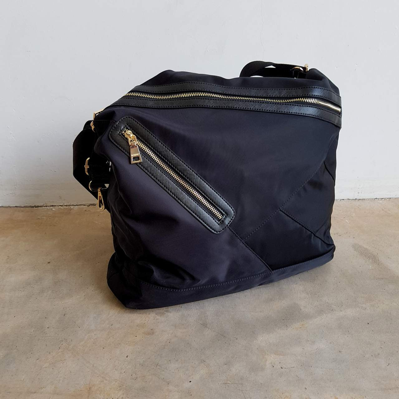 Soft nylon twill handbag that converts into backpack with zip features.  Black. 13ad2f3cbc9bf