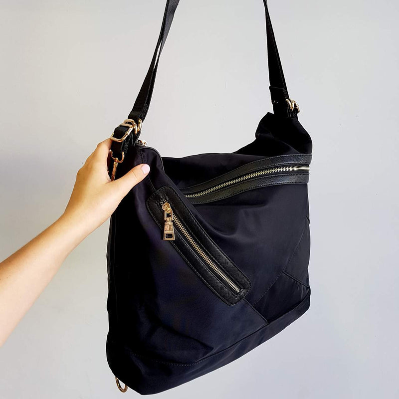 Soft nylon twill handbag that converts into backpack with zip features.  Black.