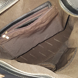 Inside picture. Soft nylon twill handbag that converts into backpack with zip features.  Black.
