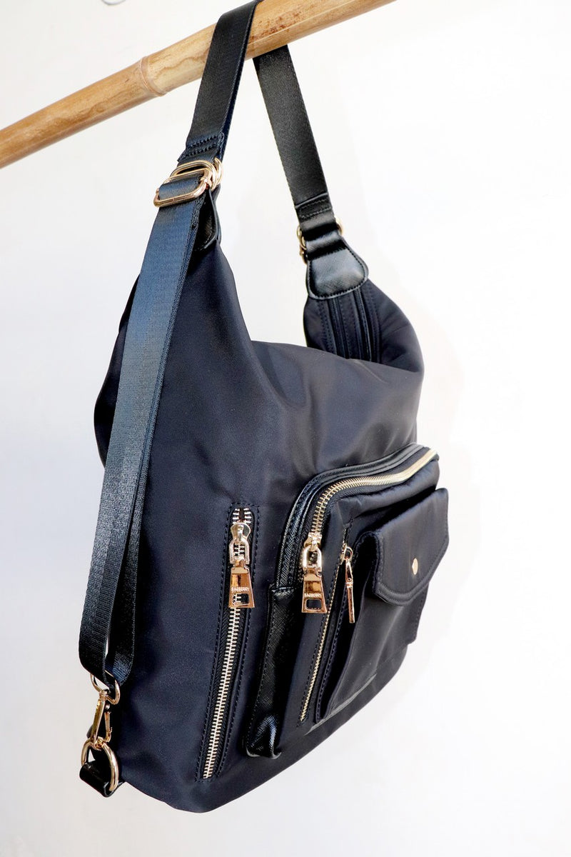 Globetrotter Messenger Satchel Backpack perfect for travel with lots of pockets. Stone, black, navy blue.