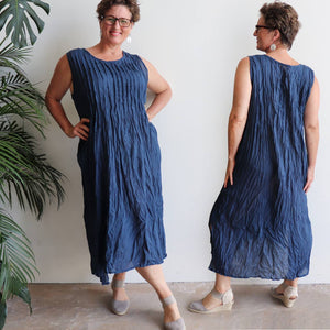 Long, sleeveless Summer dress with pintuck detail on bust. Made of crinkle textured cotton with pockets. Plus Size. Navy Blue.