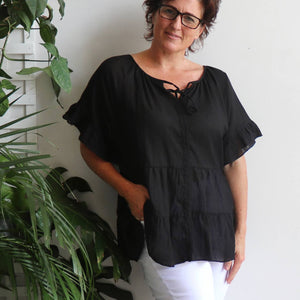 Flowing free size white cotton blouse perfect for our hot Australian summer season. Plus size style. Black.