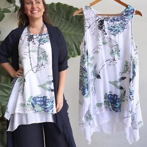 Womens sleeveless, tunic shirt top for casual or formal spring to summer wear in floral watercolour print. Long and layered flattering a-line tank cut available in plus sizes up to 22.
