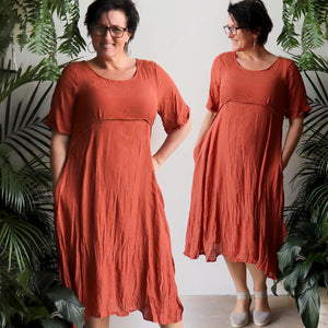 Womens below the knee summer dress is fully lined with side seam pockets. Chic + classic a-line shaping ,made with a lightly textured 65%-35% cotton/poly blend. Sizes 8/10 to 18/20. Desert.