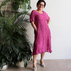 Womens below the knee summer dress is fully lined with side seam pockets. Chic + classic a-line shaping ,made with a lightly textured 65%-35% cotton/poly blend. Sizes 8/10 to 18/20. Magenta Pink.