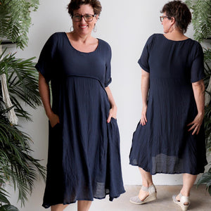 Womens below the knee summer dress is fully lined with side seam pockets. Chic + classic a-line shaping ,made with a lightly textured 65%-35% cotton/poly blend. Sizes 8/10 to 18/20.
